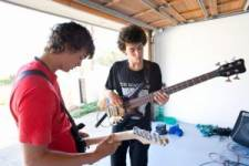 Kids plays guitar in the garage
