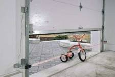 PHOTO-EYE reversal system stopping a garage door closing on a bike